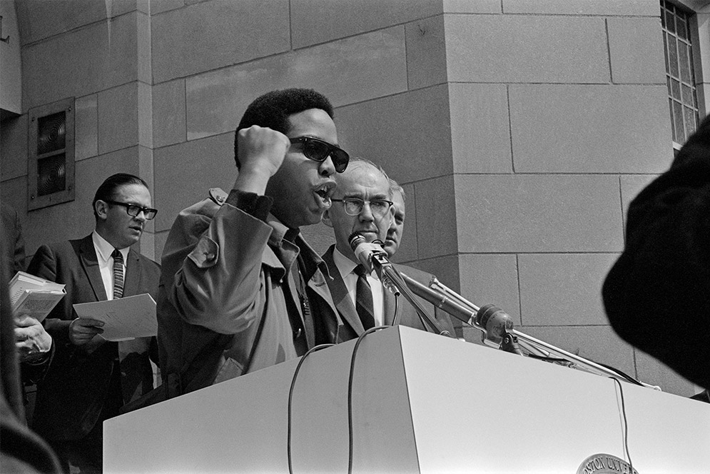 Ed Coaxum speaks at a memorial service on for Martin Luther King, Jr. the day after he was assassinated, Marsh Plaza, Boston University, 1968