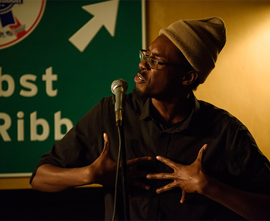 Evan Jymaal Cutts performs at a poetry slam.