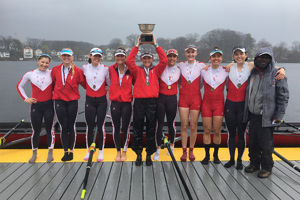 The Boston University Terriers women's lightweight rowing team hold their gold medal trophy from the 2018 Eastern Sprints.