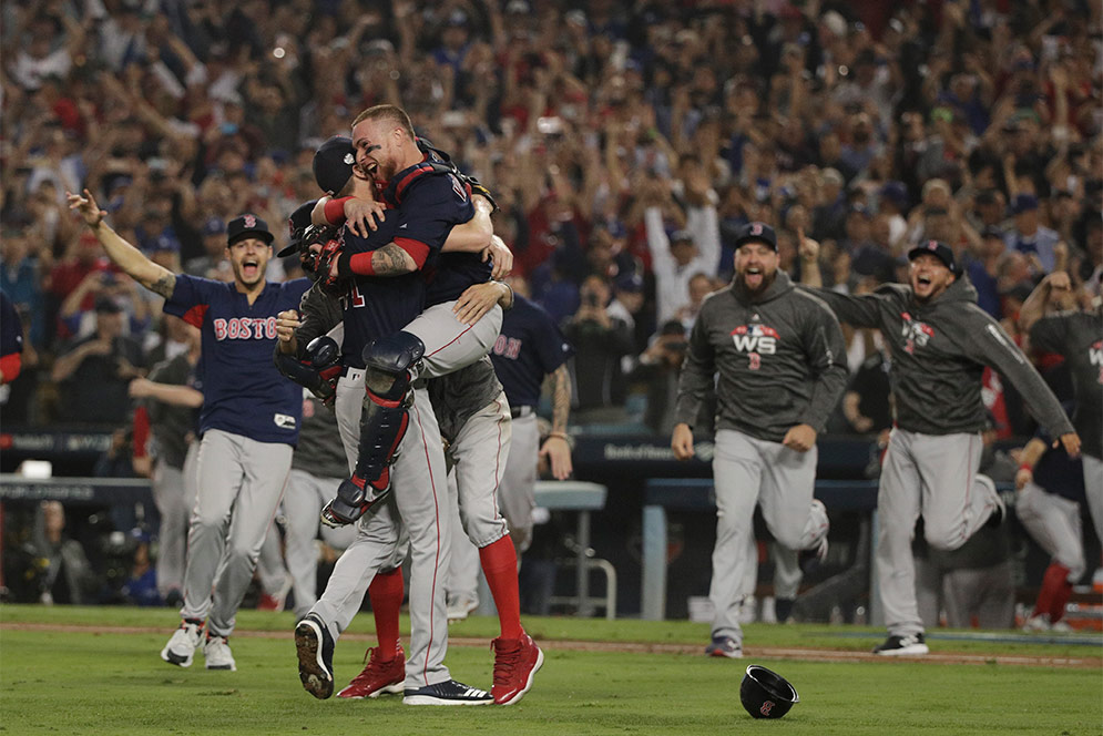 Catcher Christian Vazquez hugs Chris Sale on the pitchers mound celebrating after the Red Sox made the last out to win the 2018 World Series