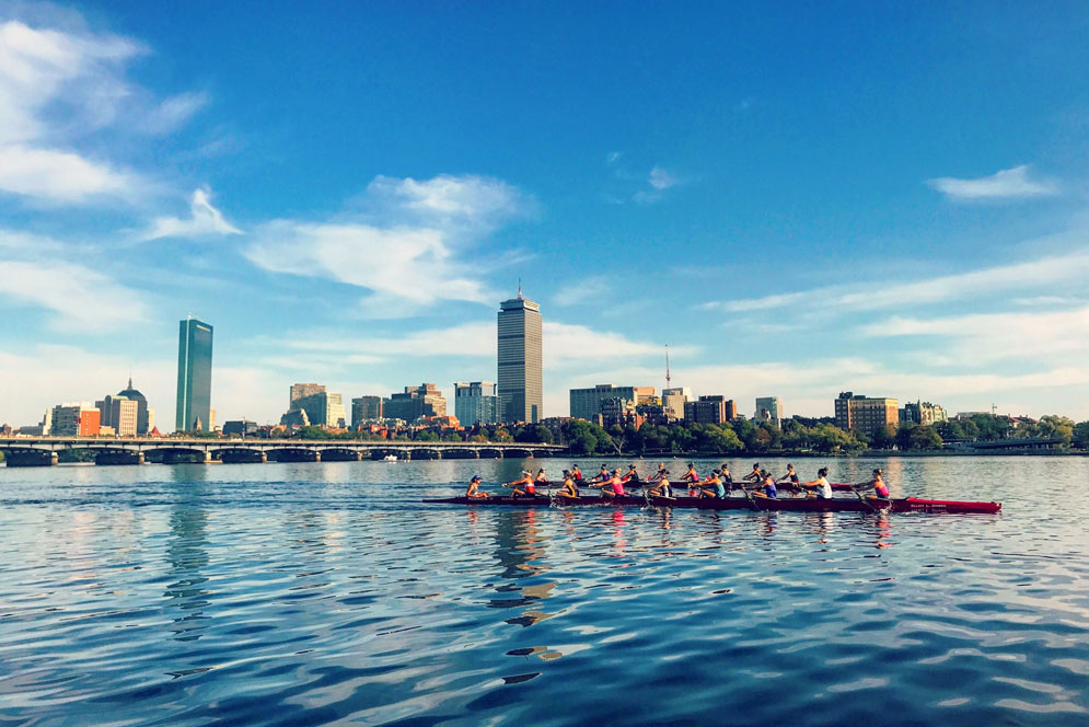 The BU women's rowing lighweight team practicing on the Charles River