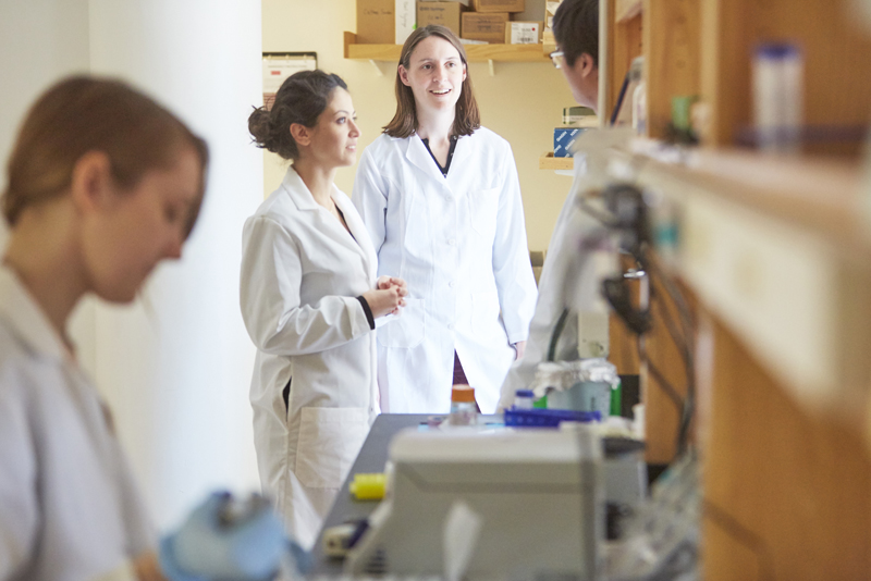 Assistant Professor Mary Dunlop (right) and postdoctoral fellow Imane El Meouche in a lab