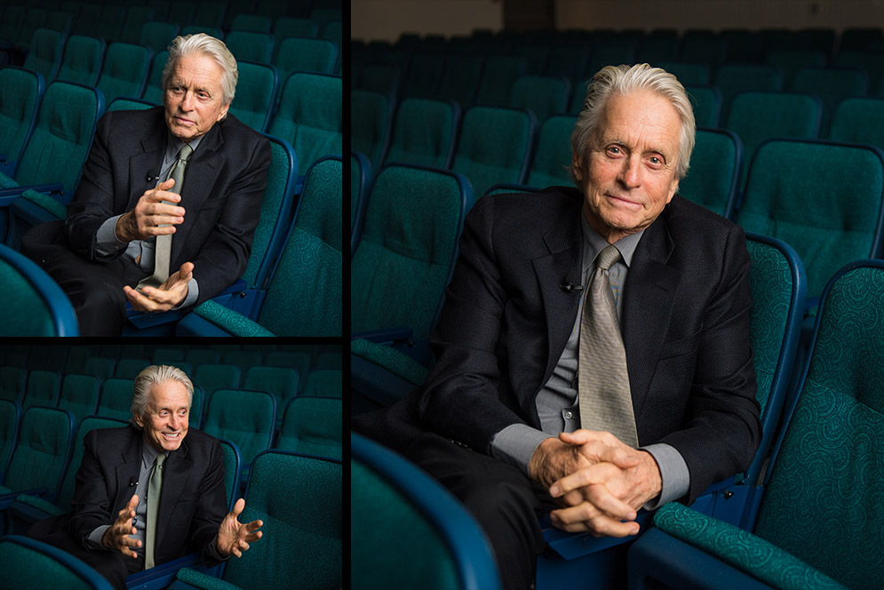 Composit of three portraits of Oscar winning actor Michael Douglas sitting in the Boston University George Sherman Union auditorium speaking, laughing, and smiling for the camera.