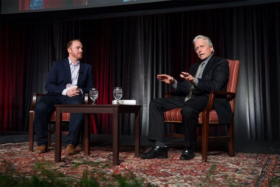 NPR host Jeremy Hobson leads a discussion with actor Michael Douglas on stage at the Boston University George Sherman Union.