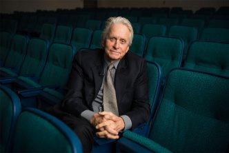 Portrait of Oscar winning actor Michael Douglas sitting in the Boston University George Sherman Union auditorium.