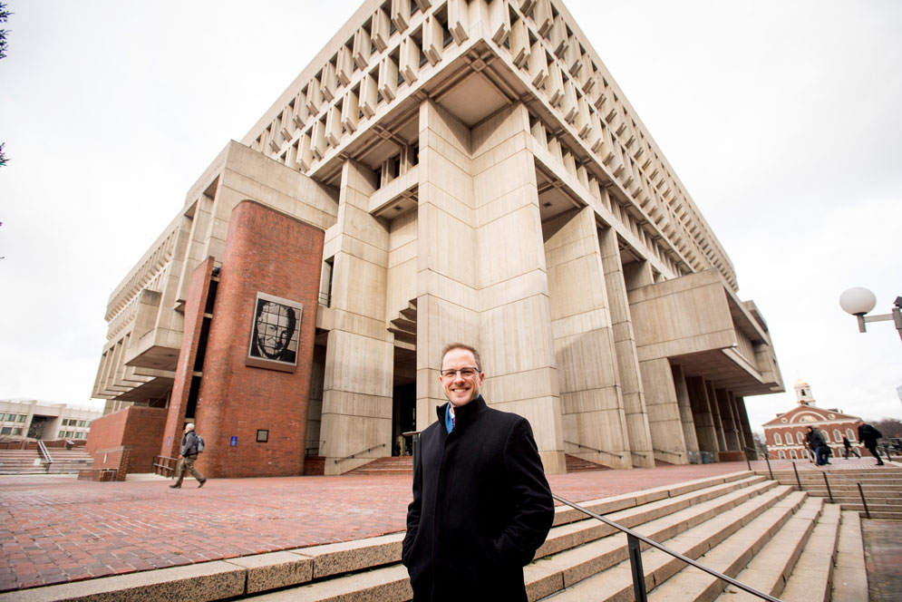 "Brian Sirman (CAS'02, GRS'08,'14), a lecturer in the CAS Writing Program, says he became fascinated by Boston City Hall because it is a building that ""was so widely and vehemently hated."" Photo by Cydney Scott"