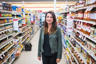 Researcher Didem Kurt poses for a photo in a grocery store