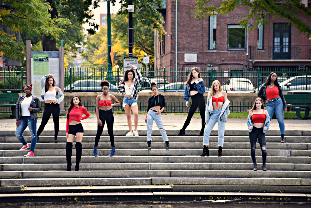 Portrait of the Vibes women-only dance team posing on stairs outside in Boston