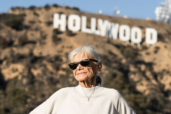 Jo Farkas poses for a photograph in front of the iconic Hollywood sign