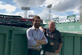 Chris Stokum (GRS'21) (left) and Red Sox team historian Gordon Edes at Fenway Park