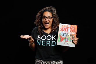Raakhee Mirchandani holds her book Super Satya Saves the Day