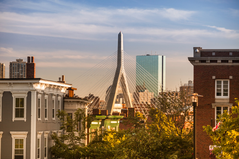 A picturesque scene of Boston and the Zakim bridge at sunset