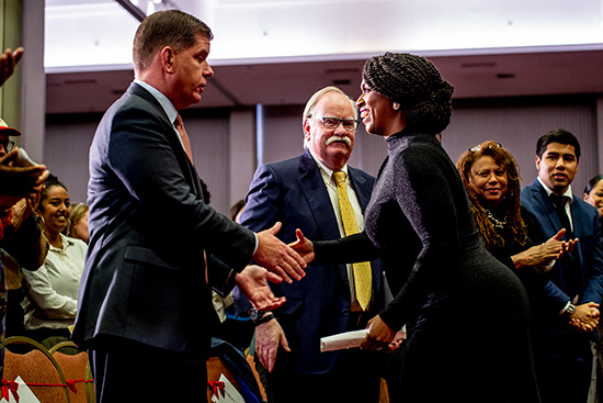 Boston Mayor Martin J. Walsh and United States Representative from Massachusetts Ayanna Pressley shake hands at the Boston University and City of Boston Martin Luther King Day observance at Marsh Chapel.