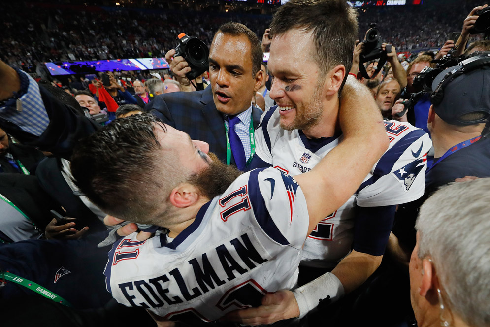 New England Patriots quarterback Tom Brady and exuberant Super Bowl LIII MVP Julian Edelman after the Pats' 13-3 victory over the Los Angeles Rams Sunday. Photo by Kevin C. Cox/Getty Images.