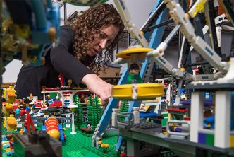 Sea Urchin biology researcher Cynthia Bradham works on constructing a new part of her LEGO city that took her more than 10 years to build.