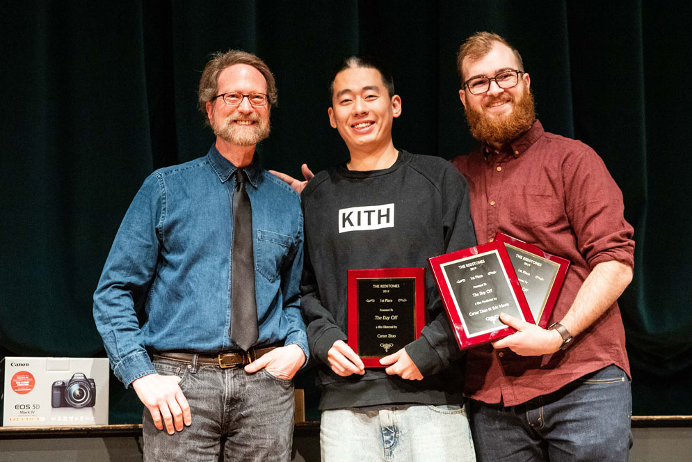 Goeff Poister presents the best film award to Zhinan Zhao (COM'18) and Eric Moots (COM) during the Redlist Film Festival award ceremony on Friday night at the Tsai Performance Center. Photo by Jacob Chang-Rascle (COM'22)