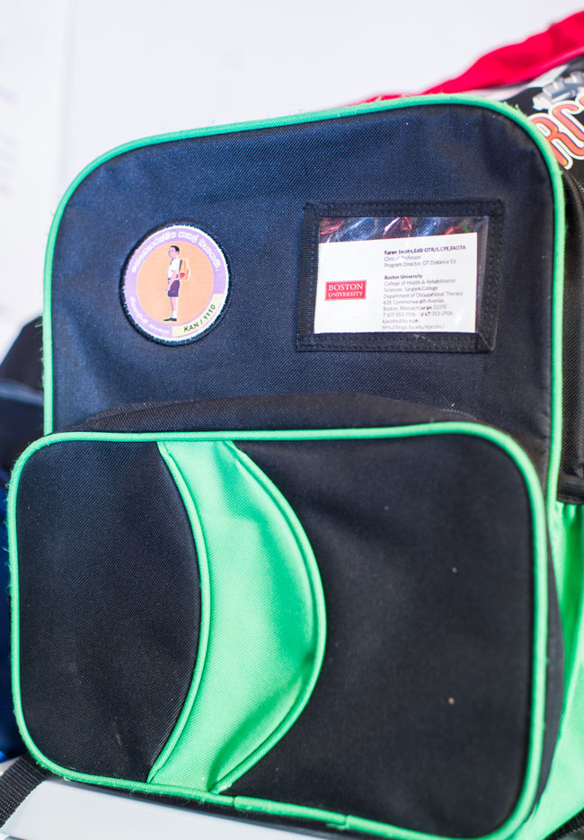 a green and black backpack