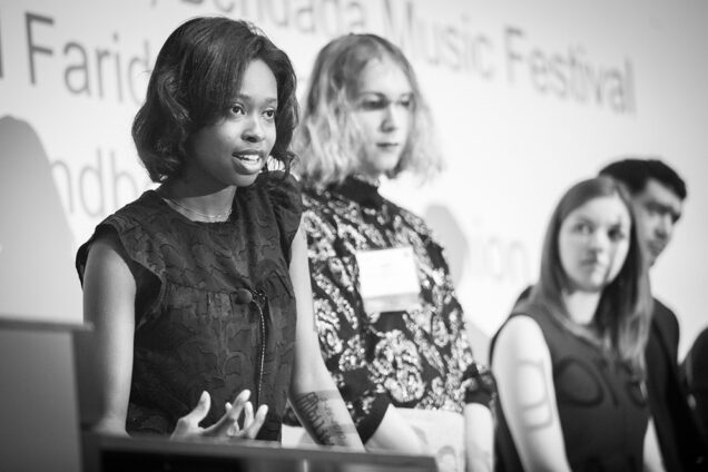 BU entrepreneurs Ellice Patterson, Dielle Lundberg, and Ines Andrade answer questions at the podium during the IDEA 2019 conference.