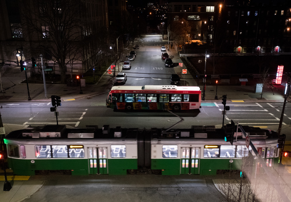 an MBTA Green Line B trolley and the BUS (BU Shuttle) pass on Commonwealth Ave