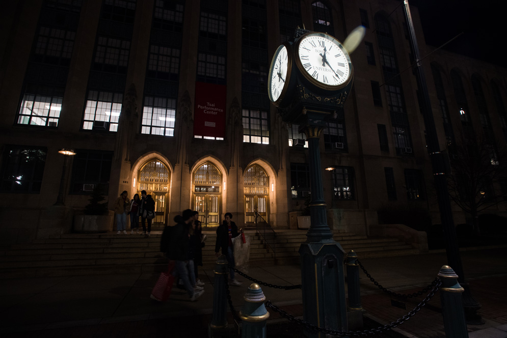 The clock outside the Tsai Performance center at night