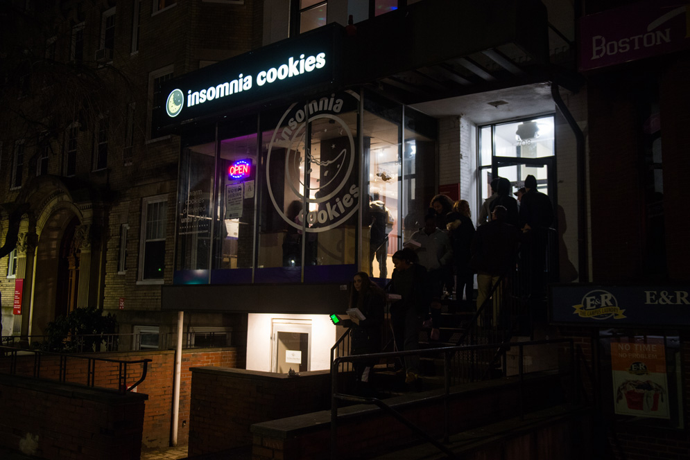 Students form a line outside of Insomnia cookies