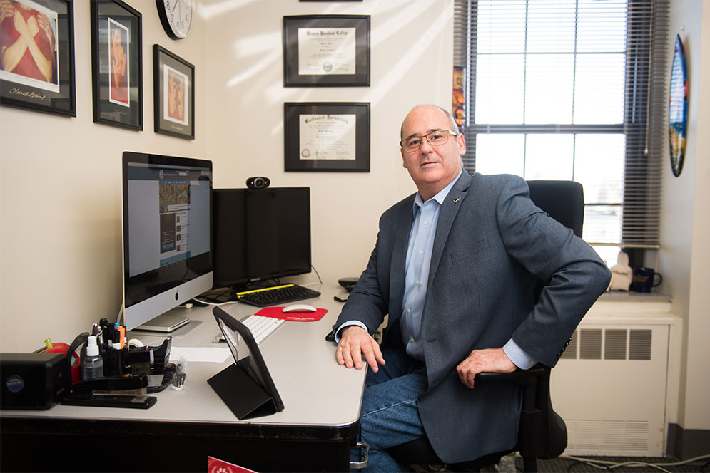 Bruce Bucci, Deaf Studies instructor at Boston University Wheelock College, poses for a portrait in his office.
