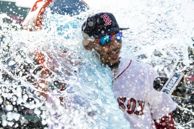 Mookie Betts is dowsed with Gatorade after hitting three home runs against Kansas City in 2018.