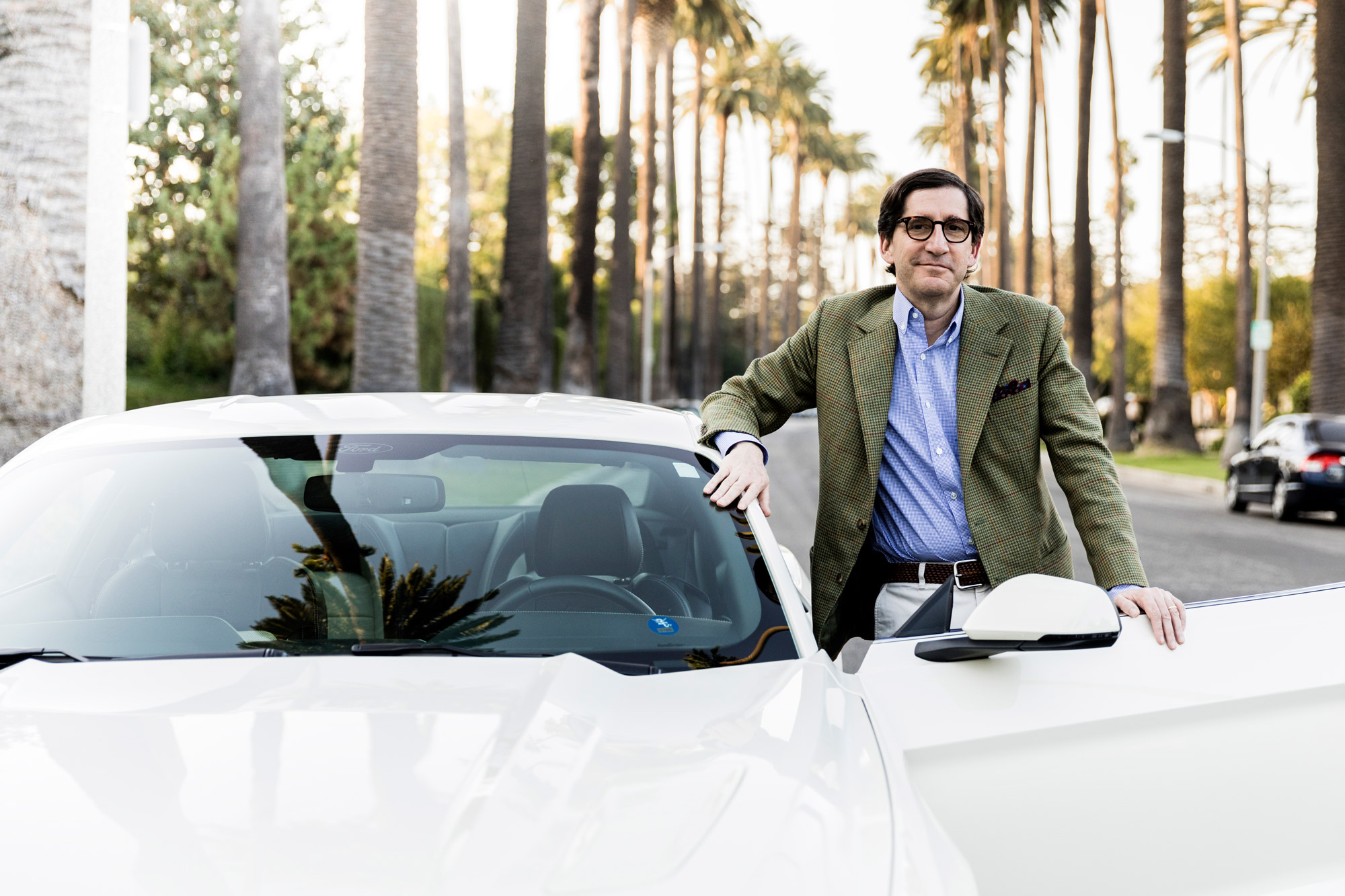 Alessandro Uzielli poses with a white mustang