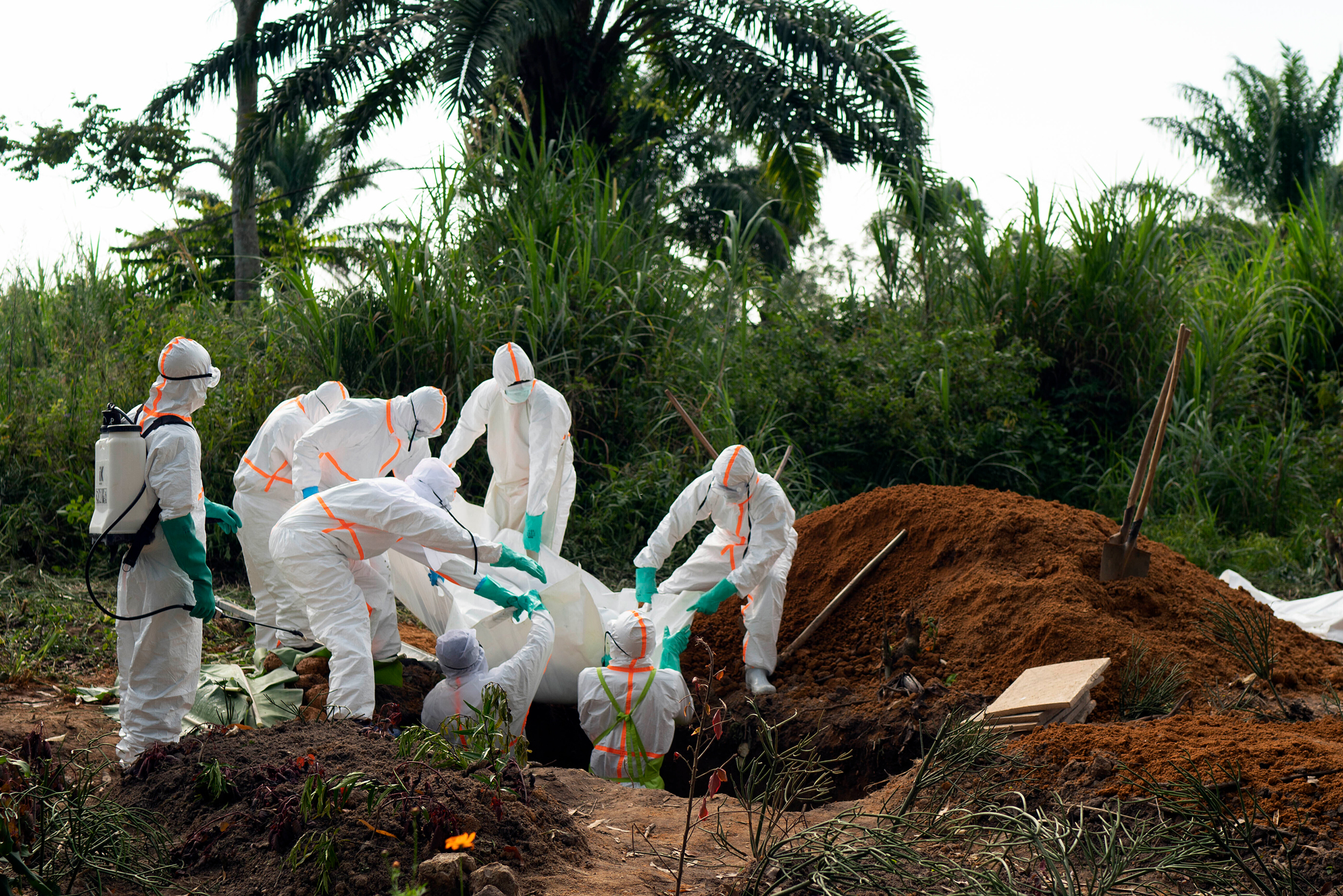 An Ebola victim is put to rest at the Muslim cemetery in Beni, Congo DRC