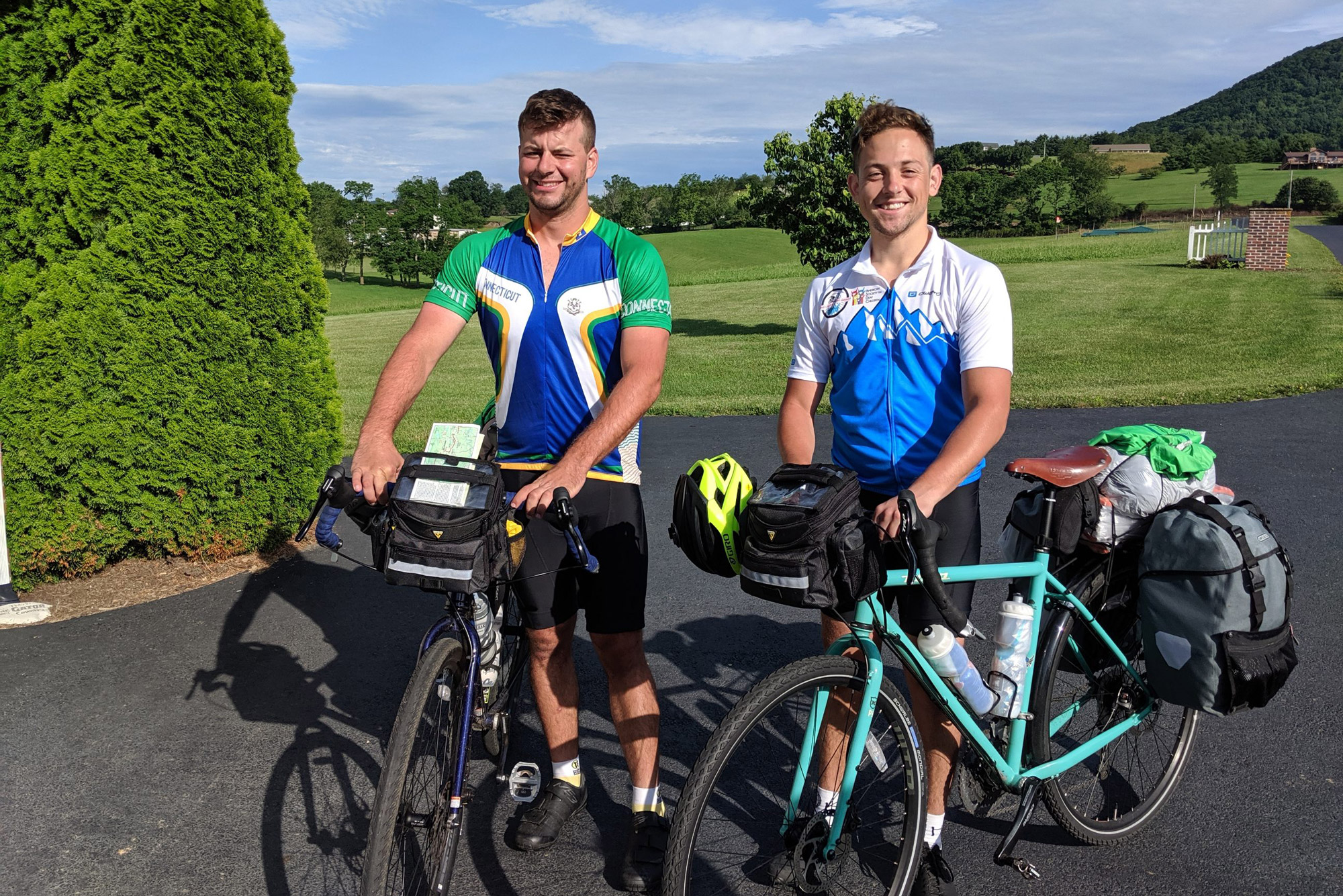 Albert Blake (left) and Conrad Baer (Wheelock'19) stand with their bikes