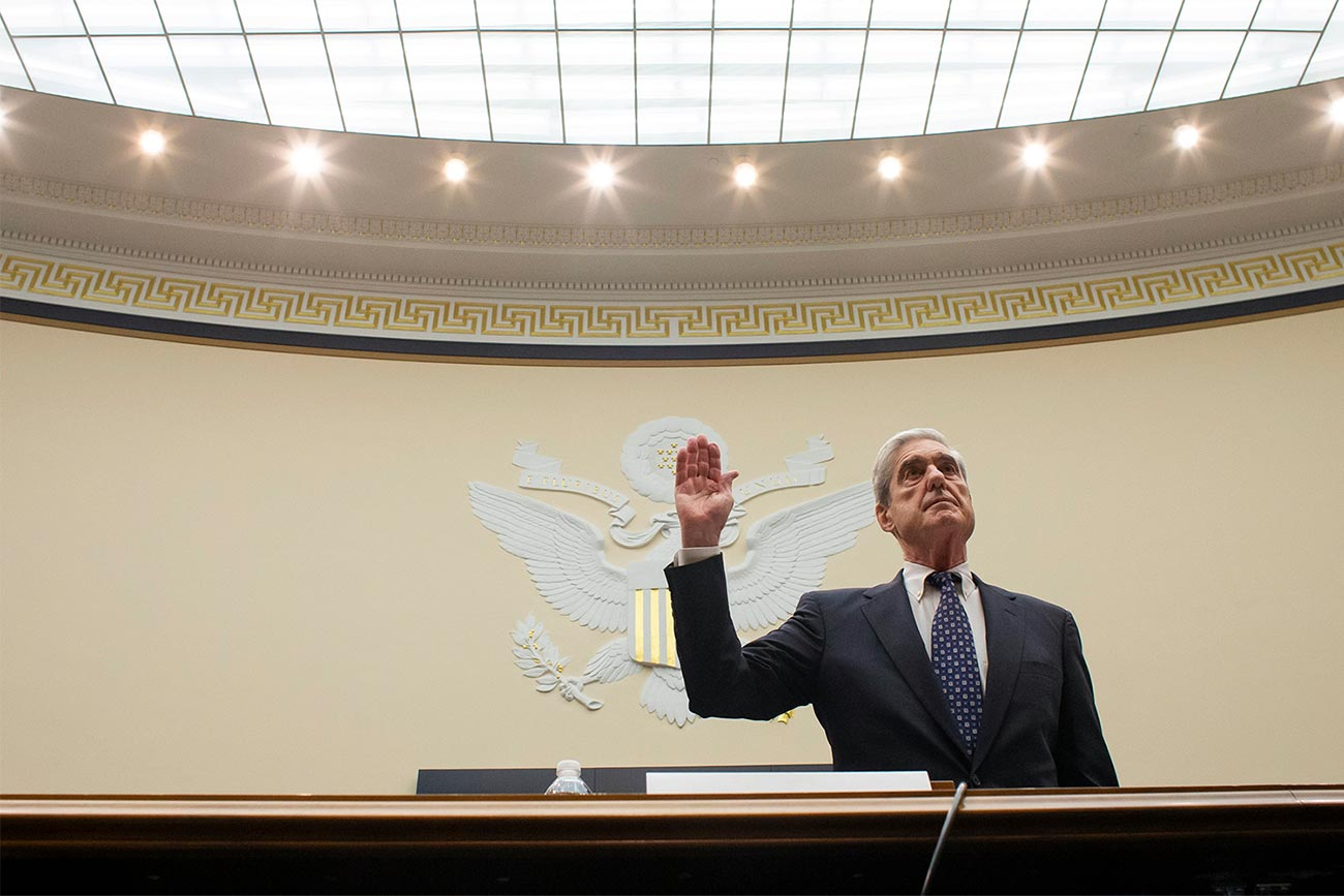 FBI Director Robert Mueller swears to testify under oath before the Congressional hearing committee.
