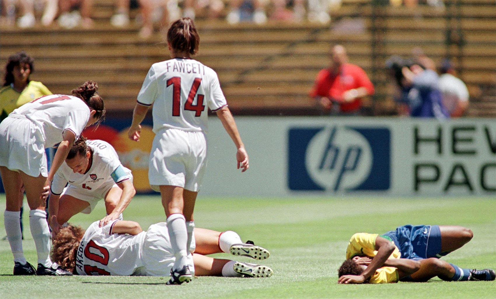 US midfielder Michelle Akers and Brazil's Grazielle lie injured after going up for a header at the Women's World Cup semi-final match between the US and Brazil 04 July, 1999.