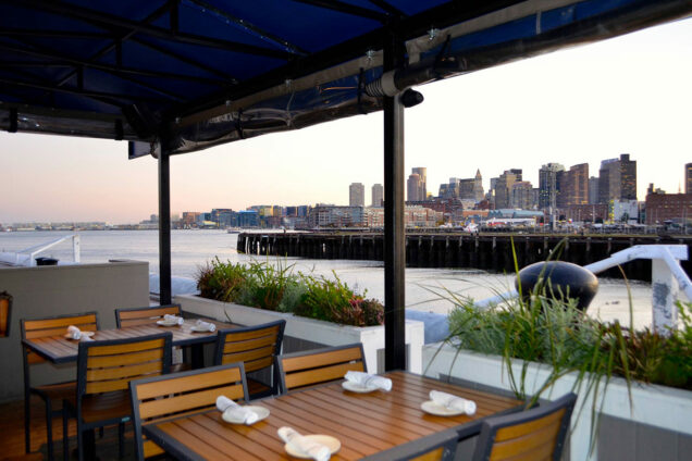 View of Boston Harbor and Boston city skyline from the patio of Pier 6 restaurant.