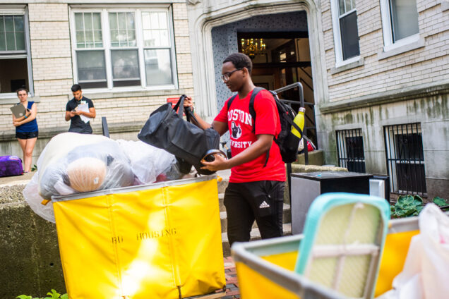 Kenise Neal (CAS 22) transports his belongings during move-in