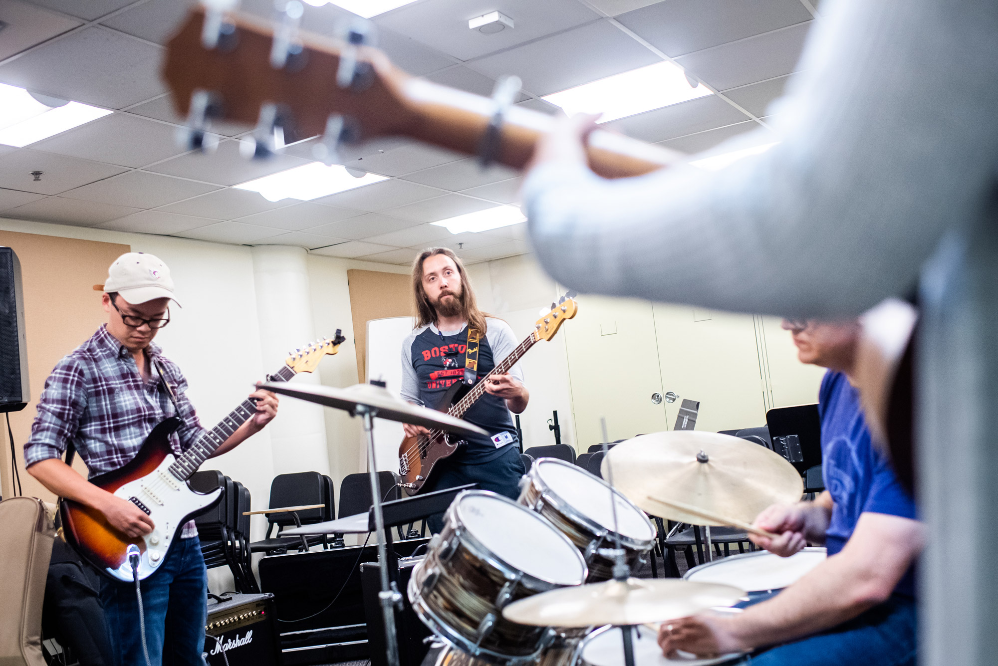 Michael Soo (left) and Aidan Linden getting ready to kick out the jams in Rock Band Performance & Pedagogy, a Summer 2 class at the College of Fine Arts