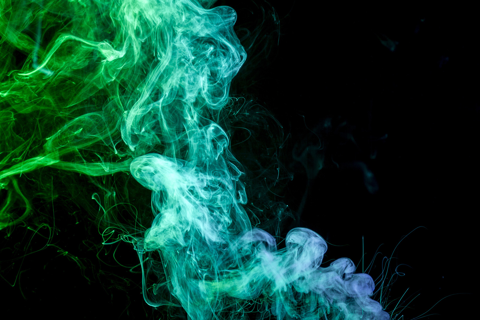 Cloud of smoke against a black background