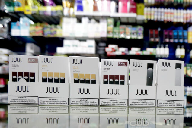 Packages of Juul e-cigarette products are seen on display at a smoke shop.