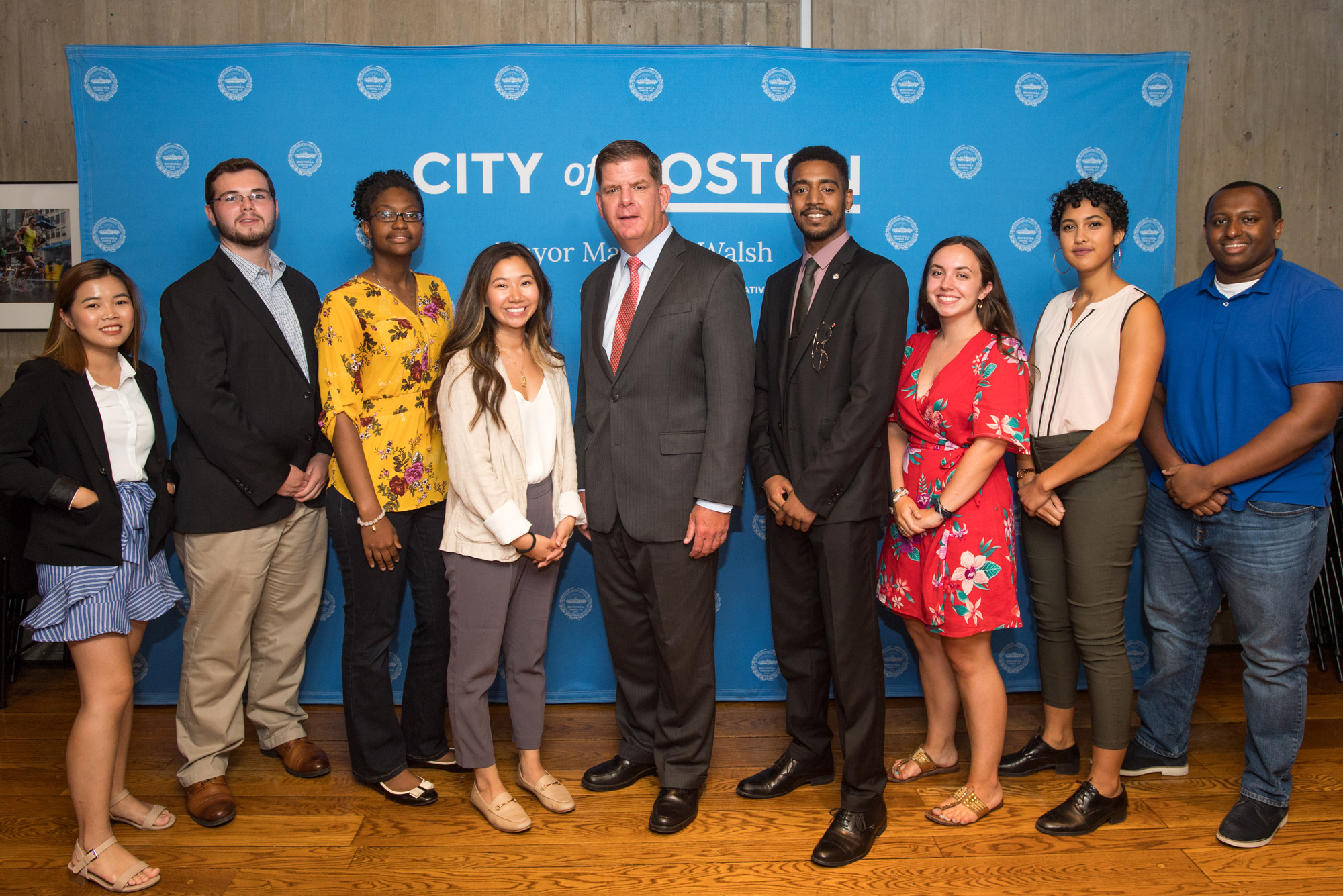 The city hall interns pose with Mayor Walsh
