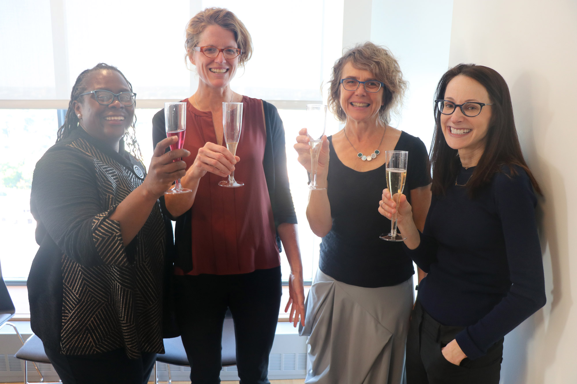 Angela Onwauchi-Willig (from left), Kristin Collins, Stacey Dogan, and 2019 MacArthur Fellowship winner Danielle Citron celebrate Citron's MacArthur Fellowship.