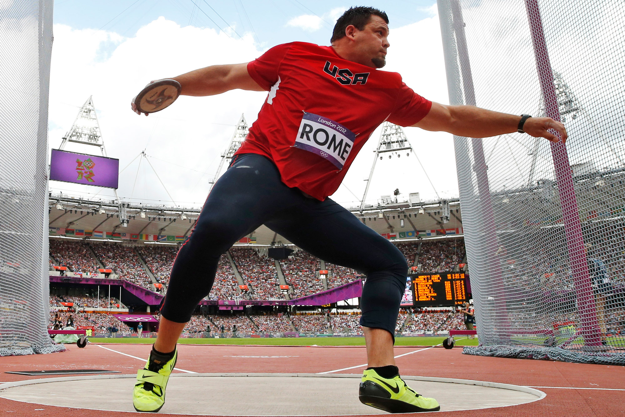 United States' Jarred Rome takes a throw in the men's discus throw qualification round during the athletics in the Olympic Stadium at the 2012 Summer Olympics, London