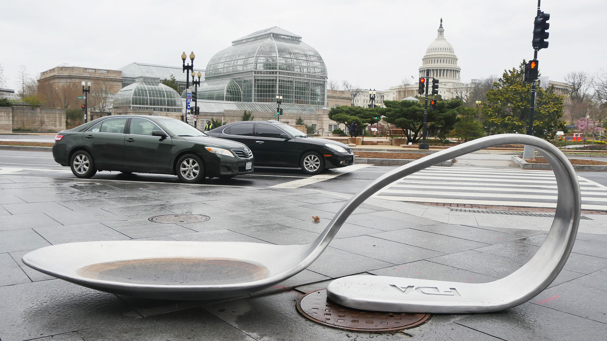 Domenic Esposito's FDA Spoon sculpture displayed on a sidewalk in Washington D.C.