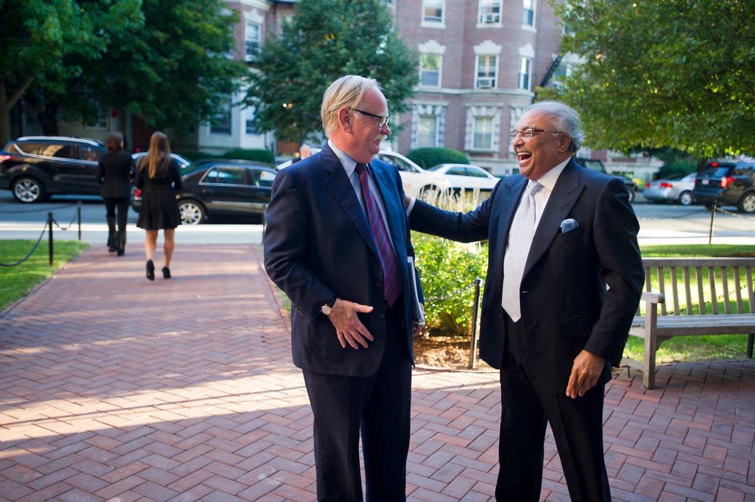 Rajen Kilachand and Boston University President Robert A. Brown exchange a laugh.