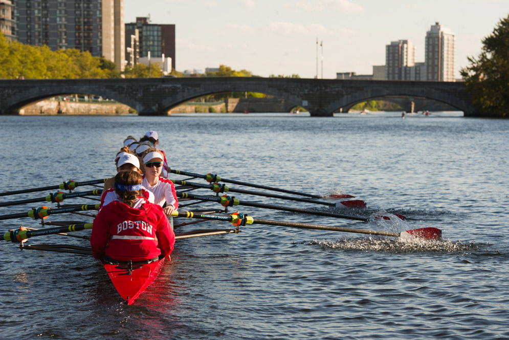 The BU women's lightweight rowing team practices on the Charles River