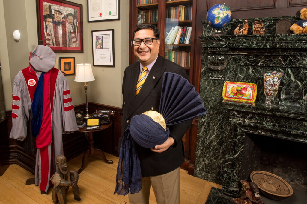 Adil Najam, Pardee School Dean, stands in his office