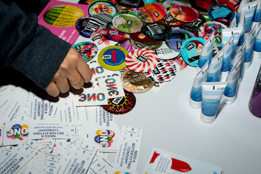 An array of condoms and other sexual health products on a table as part of the annual Sex in the Dark panel