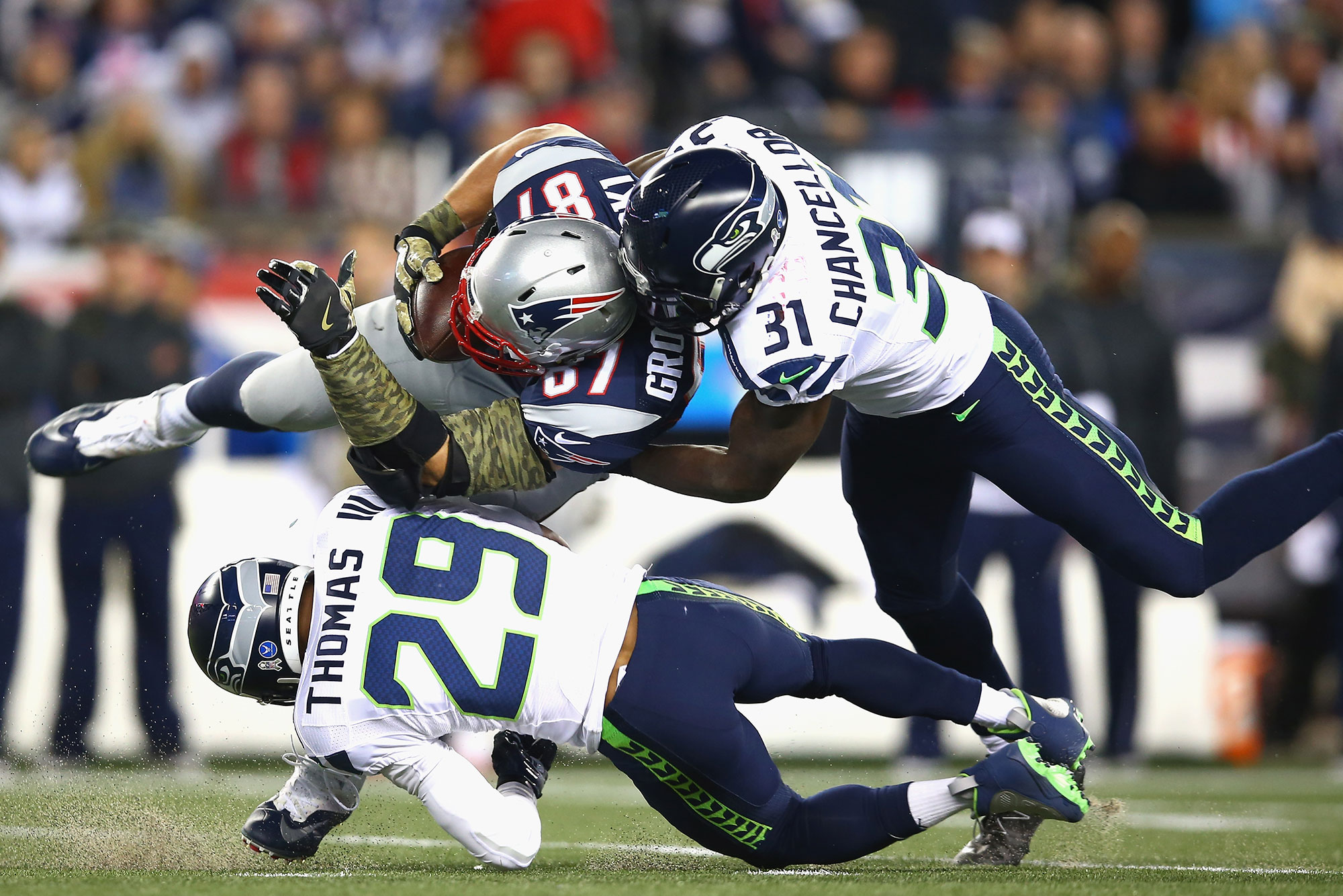 Patriots player Rob 'Gronk' Gronkowski gets tackled during a game against the Seattle Seahawks.