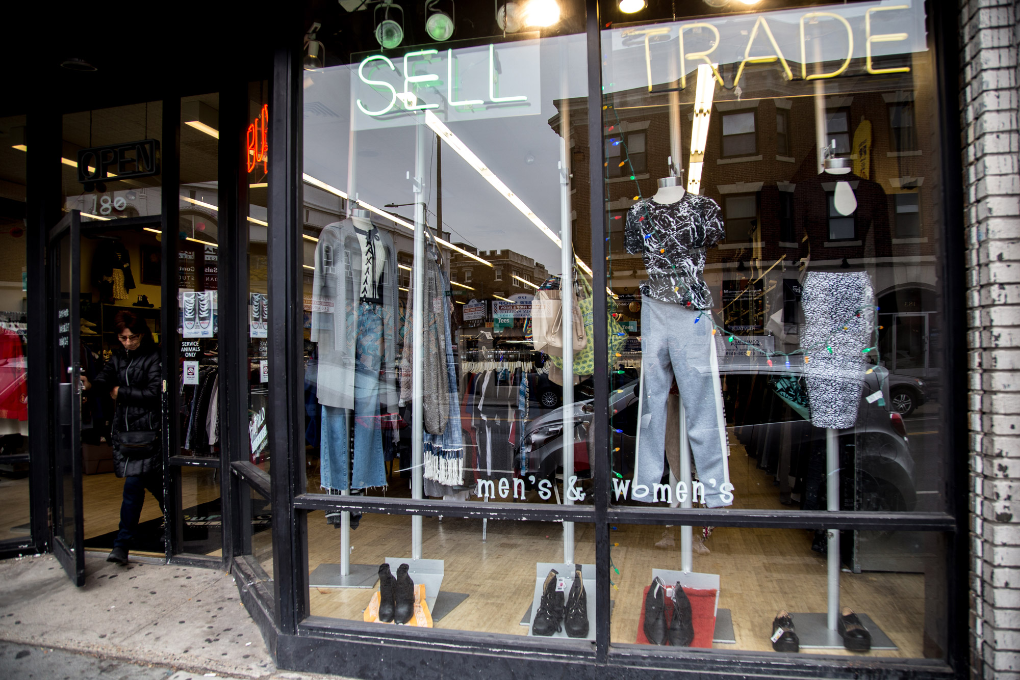 A photo of clothing displayed in the window at Buffalo Exchange