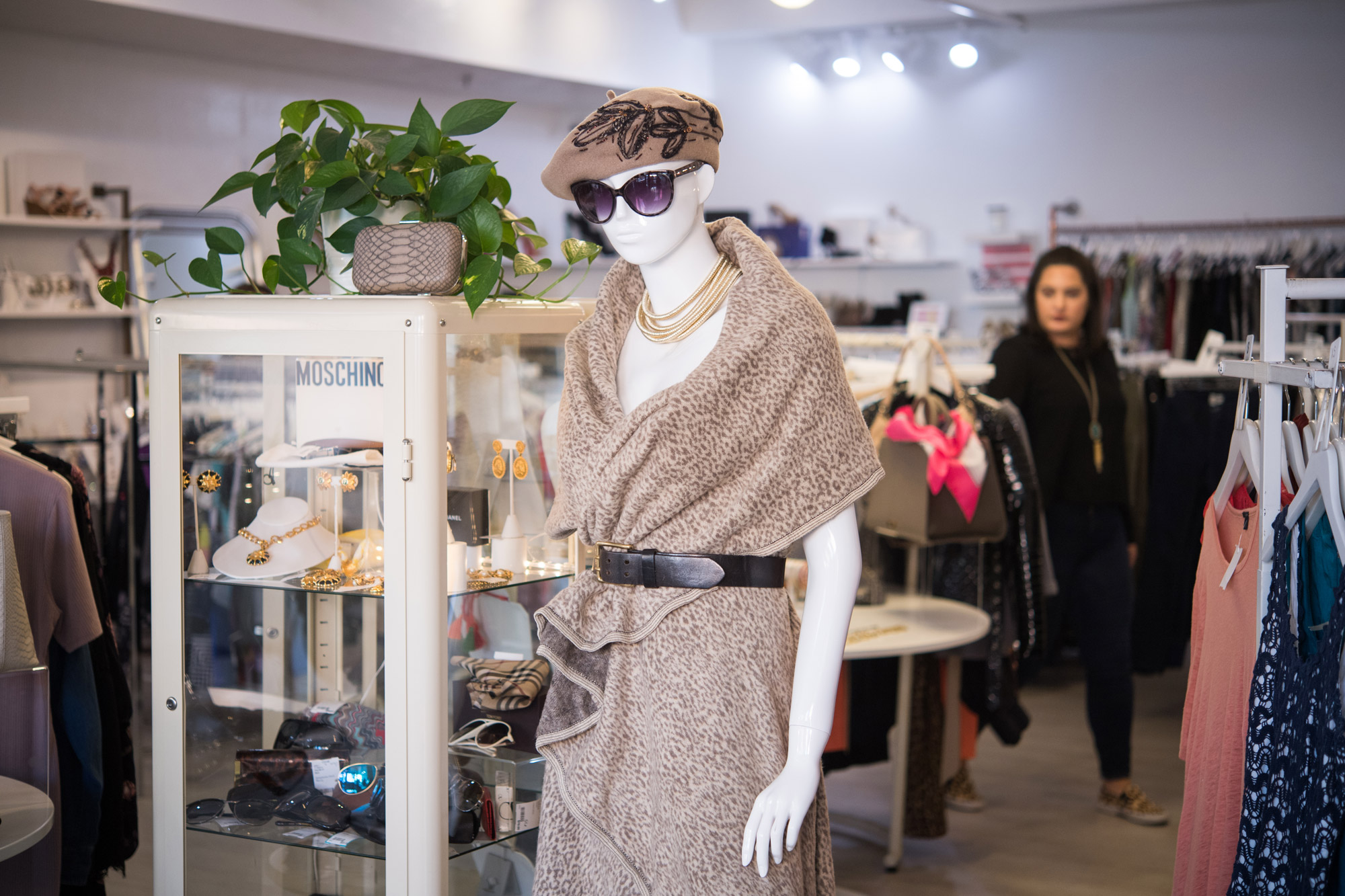 A mannequin inside Covet is draped in fashionable cheetah print