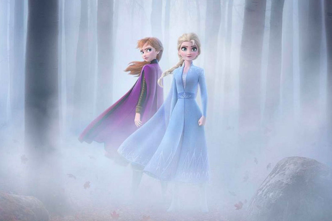 A movie poster for Frozen II depicting Anna and Elsa in a wooded area