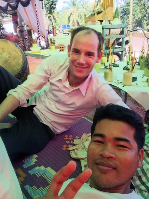 Jeffrey Dyer poses for a photo while performing music in Cambodia